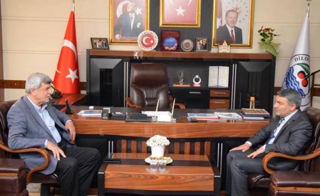 Karaosmanoğlu'ndanŞayir'e Hayırlı olsun ziyareti