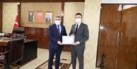 Kaymakam Alkan'dan, Başkan Şayir'e teşekkür belgesi